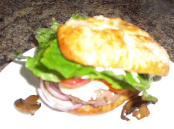 Put cut pretzel buns on your grill and toast, add one burger to bottom...