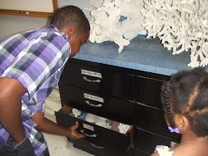 Photo: Miles opening drawers