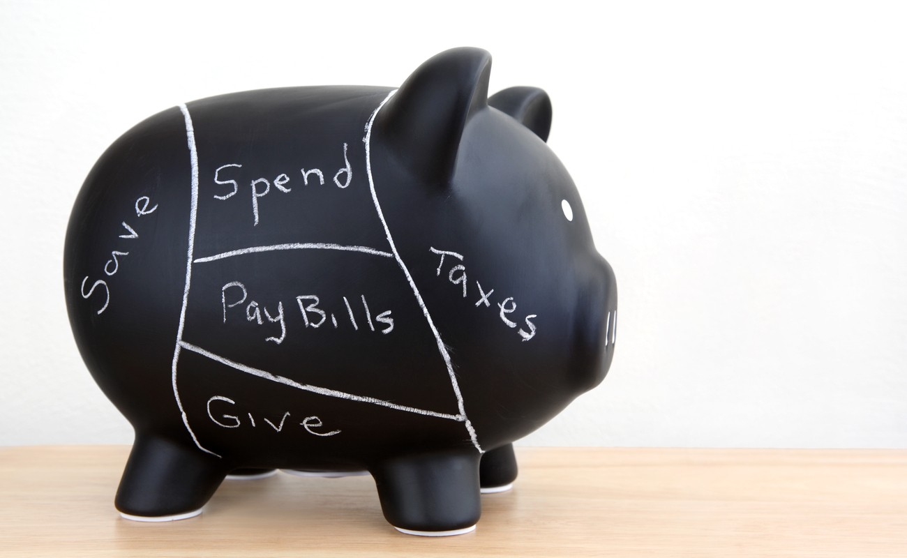 Black piggy bank with white lines to seperate spendings