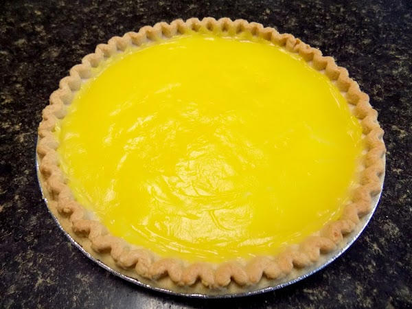 When pie crust has cooled to room temperature, spread lemon pie filling over the...