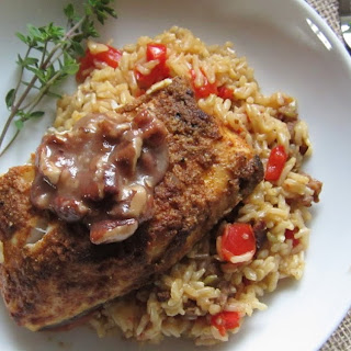 Cajun Halibut served with Dirty Rice and Praline Sauce