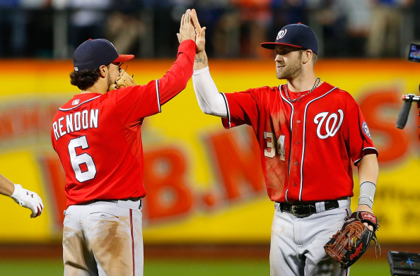 NEW YORK, NY - SEPTEMBER 13:  Bryce Harper #34 and Anthony Rendon #6 of the Washington Nationals celebrate after defeating the New York Mets at Citi Field on September 13, 2014 in the Flushing neighborhood of the Queens borough of New York City.  (Photo by Jim McIsaac/Getty Images)