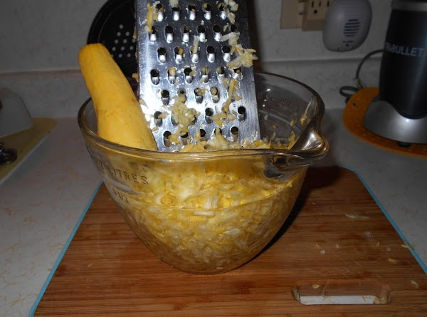 3.Grate the zucchini skin and all.