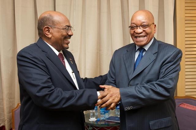 Sudan's Omar Al-Bashir and President Jacob Zuma share one of many happy moments. Picture: GCIS