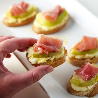 Prosciutto Pear Brie and Honey Crostini.