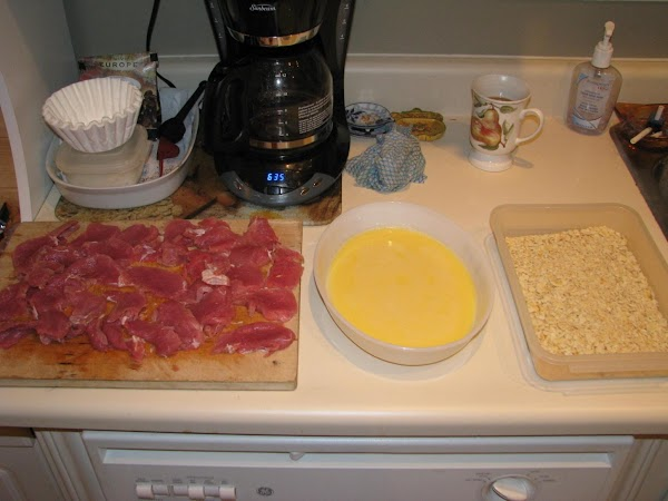 Have an assembly line of: Slices of pork Beaten eggs mixed with a little milk Crushed crackers
