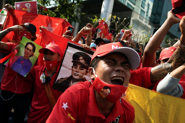 NLD supporters shout slogans in front of the Myanmar embassy in Bangkok, Thailand, during a rally on February 1 2021 after the military seized power from a democratically elected civilian government and arrested its leader Aung San Suu Kyi.