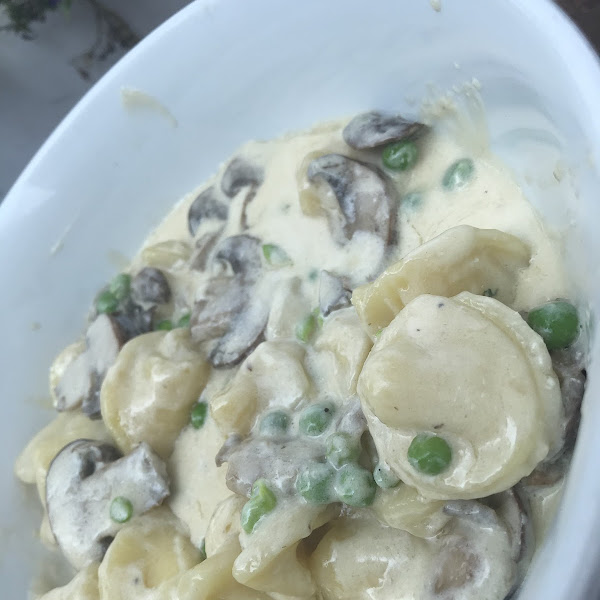 Fresh GF four cheese tortellini with mushrooms and peas