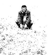 Photo: Freedom fighter Yakub Ali, in front of the graveyard of commander Malek