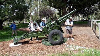 Photo: Load! Fire! Guys at work on the Hall 25 Pounder at the Hall Memorial