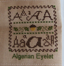 "Photo: Completed 9 January 2009. Sampler Book ""A"" (2006) by Erica Michaels stitched on Amber 32ct linen. The stitching was done in Needle Necessities silks. Stitch count: 53w x 60h."