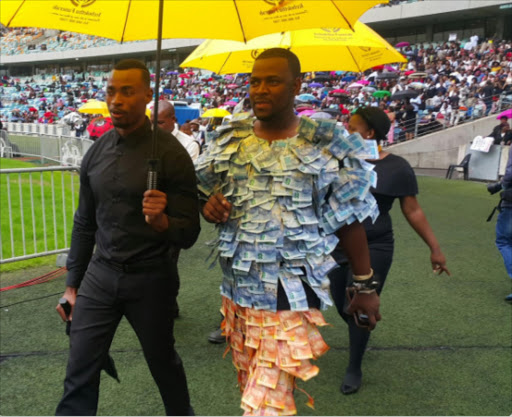 Durban herbalist gets tongues wagging with 'money suit' at