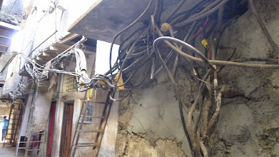 Photo: Electrical wiring is very shotty.  Also notice houses are stacked on top of one another, up to 4 stories tall (all built with scrap wood, metal and plaster).