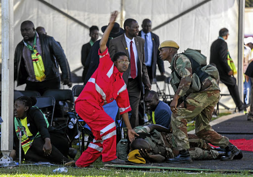 Medics attend to people injured in an explosion during Zimbabwean President Emmerson Mnangagwa's election rally in Bulawayo on June 23 2018. Picture: TAFADZWA UFUMELI VIA REUTERS