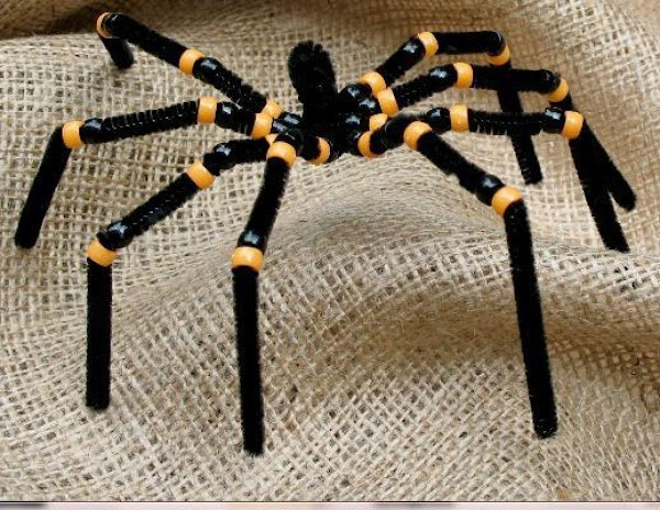 for each spider you need 48 beads (24 of each color) and 4 pipe...