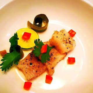 Tea smoked Basa with pickled cucumber.