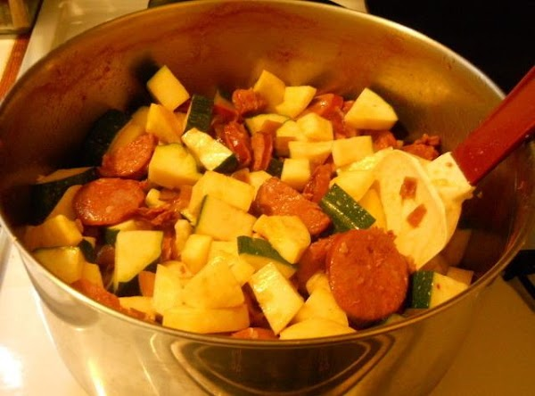 Cut up the Chourico sausages, the onion, the zucchini and the yellow squash into...