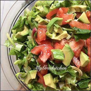 Arugula, Avocado & Spinach Salad with Pomegranate Dressing.