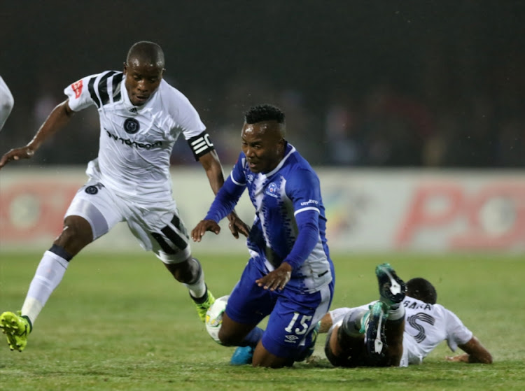 Lebohang Maboe of Maritzburg United is fouled by Orlando Pirates' captain Thabo Matlaba during the Absa Premiership match at Harry Gwala Stadium on September 15, 2017 in Pietermaritzburg, South Africa.