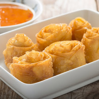 Bacon-Shrimp Spring Rolls With Pineapple Dipping Sauce.