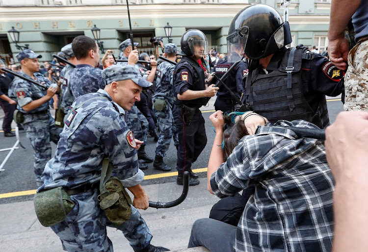 A Russian National Guard member beats a protester during a rally against planned increases to the nationwide pension age in Moscow, Russia, September 9 2018. Picture: REUTERS
