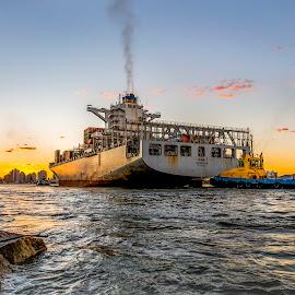 Ship in Itajai Beach at Sunset by Rqserra Henrique - Transportation Boats ( rocks, sunset, beach, ship, water, boat, rqserra )