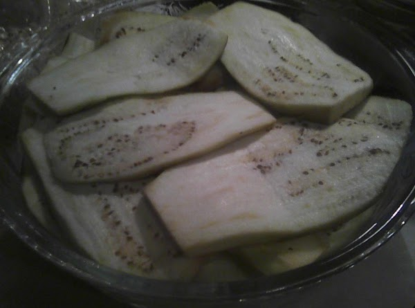 Cut the skin off the eggplant.  Cut in thin slices lengthwise.  Place...