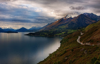 Photo: The Most Beautiful Road in the World  I've looked at travel guides and driven on a ton of beautiful, scenic roads all over the world, but I think this road to Queenstown (on the way to/from Glenorchy) is the most beautiful in the world. The road winds down one side of a perfect, fjord-like lake, and every few kilometers, the mountain views change dramatically. Depending upon the time of day you travel it, the entire landscape transforms before your eyes.  from Trey Ratcliff at http://www.StuckInCustoms.com