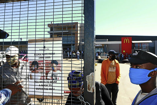 Shoppers at Dobsonville Mall in Soweto are not allowed to enter the shopping centre without wearing a mask n a bid to curb the spread of Covid-19. / Gallo Images/Fani Mahuntsi