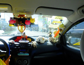 Photo: How can the taxi driver see out his window?