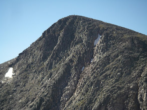 Photo: A zoomed in shot of a person atop Hallett Peak.