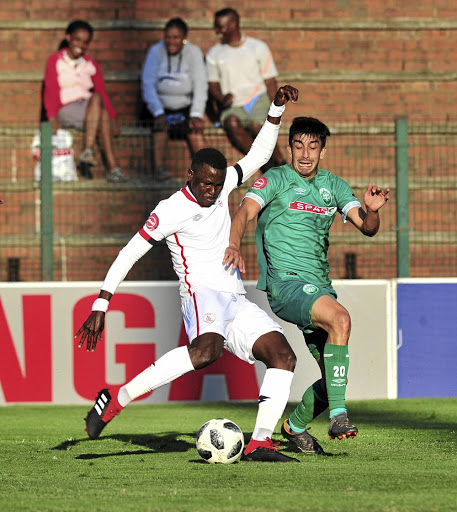 Bengali Keita of Free State Stars is challenged by Emiliano Tade on Sunday.