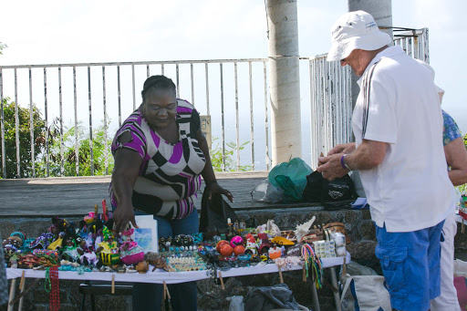 A merchant selling her goods at Shirley Heights, an overlook above English Harbour in Antigua.