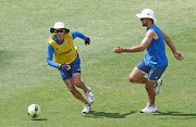 Keshav Maharaj ( l) and Aidan Markram during the South African national men's cricket team training session at Kingsmead Stadium on February 11, 2019 in Durban, South Africa.