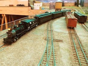 Photo: 010 A passenger train arrives at Crock, Colorado behind D&RGW 2-8-0 number 347 .