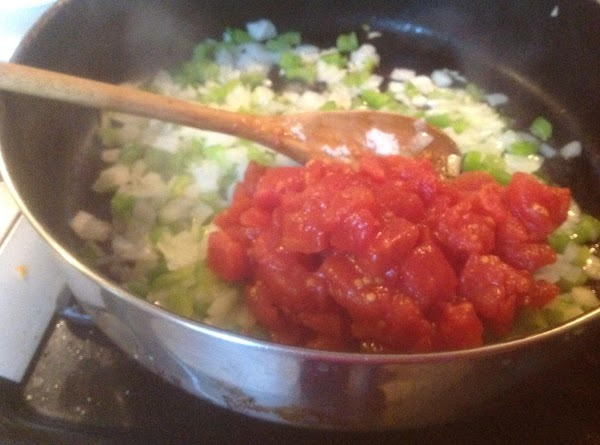 Add the coconut oil to a large skillet, then heat over medium high heat....
