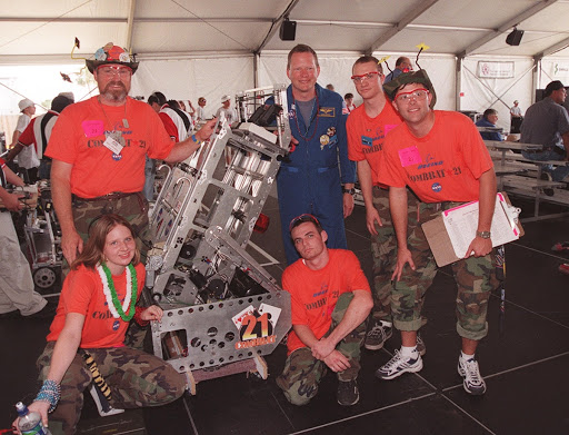 David Brown poses with members of the team known as ComBBat representing Central Florida's Astronaut and Titusville high schools.