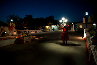 """Photo: """"Dark side of the moon""""  A """"light bearer"""" making his way for the procession of a grand Indian wedding"""