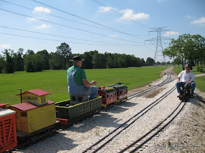 Photo: Bob Sanford with his 2.5 inch scale narrow gauge train on 7.5 inch gauge track meets Doug Blodgett with his 1.5 inch scale narrow gauge Shay on 4.75 inch gauge track.  HALS-SLWS 2009-0522