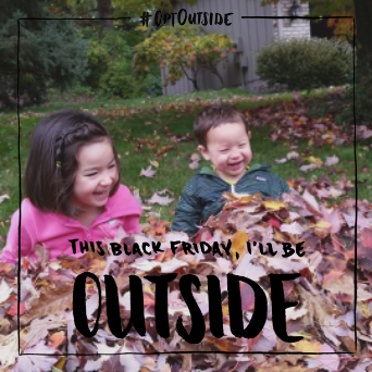 Kids playing in raked leaves