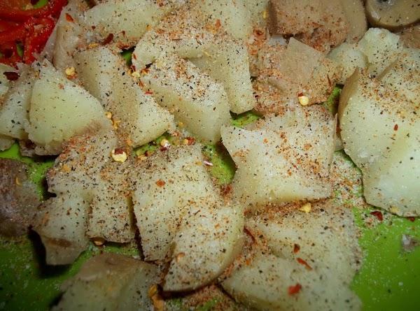 Season potatoes with salt, pepper, onion powder, Cajun seasoning and a pinch red pepper...