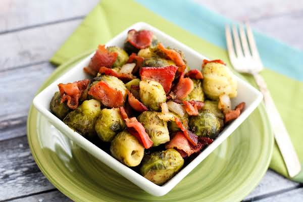 A Bowl Of Brussels Sprouts With Warm Hot Bacon Dressing.