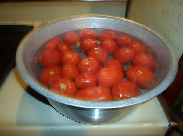 Take the Roma tomatoes and get ready to blanch them. Get a large dish...
