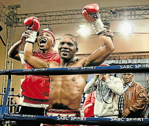 BROTHERS IN ARMS: Zolani Tete, left, celebrates with victorious older brother Makazole after one of his fights. Next month the brothers will fight in a tournament for the first time together abroad in the United Kingdom Picture: ALAN EASON