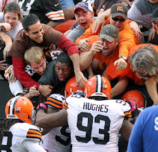 Photo: Browns defensive players celebrate with Sheldon Brown after he returned an interception for a touchdown. (John Kuntz, The Plain Dealer)