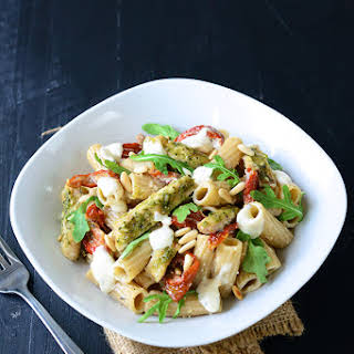 Grilled Pesto Chicken Pasta Salad with Sun-Dried Tomatoes, Arugula and Pine Nuts.