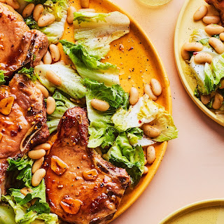 Hot Honey Pork Chops with Escarole and White Beans recipe | Epicurious.com.