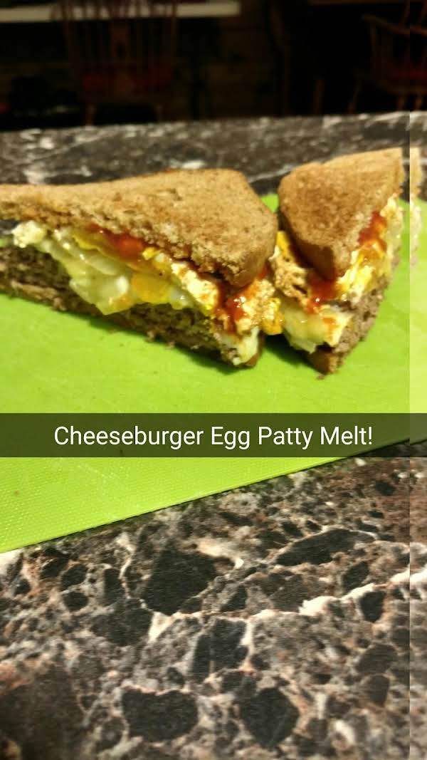 A Classic Breakfast Cheeseburger Patty Melt With Fried Onions And Ketchup!