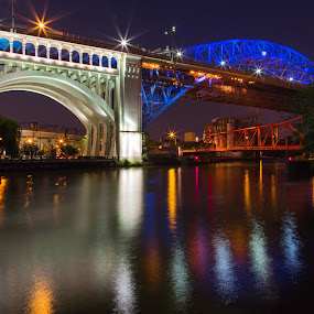 Over the Cuyahoga by David Pilasky - Buildings & Architecture Bridges & Suspended Structures ( night photography, bridge, summer solstice, cleveland flats, cleveland )