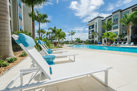 Resort-style pool with lounge chairs